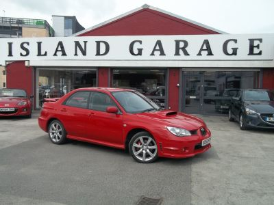 Subaru Impreza 2.5 WRX 4dr Saloon Petrol Red at Island Garage Stafford